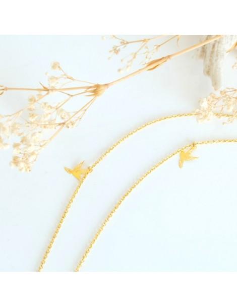 Boucle d'oreille bleue en métal doré, chaînes et perles bleues